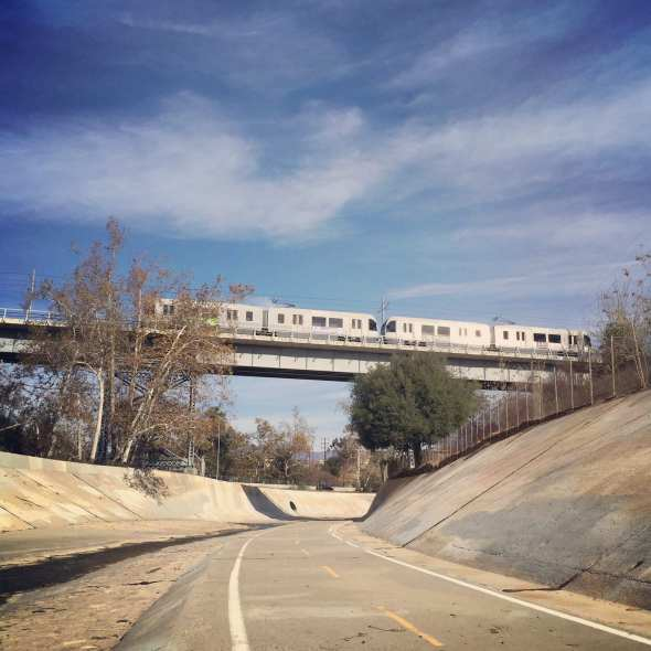 ART OF TRANSIT: Gold Line train over the Arroyo Seco Bike Path. (Photo: Anna Chen/Metro)