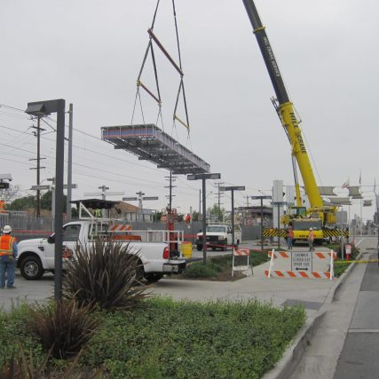 A new canopy is lifted into place at Compton Station. Photo by James Wei/Metro.