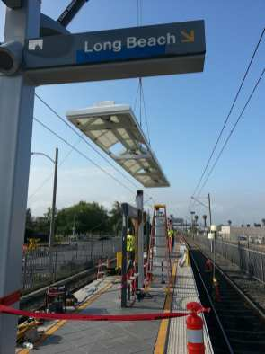 Workers install a new canopy at Florence Station last weekend...