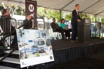 Metro Board Member and L.A. Mayor Eric Garcetti speaking at the anniversary event. In forefront is a photo from the Metro Blue Line grand opening event in 1990. Photo: Gary Leonard/Metro