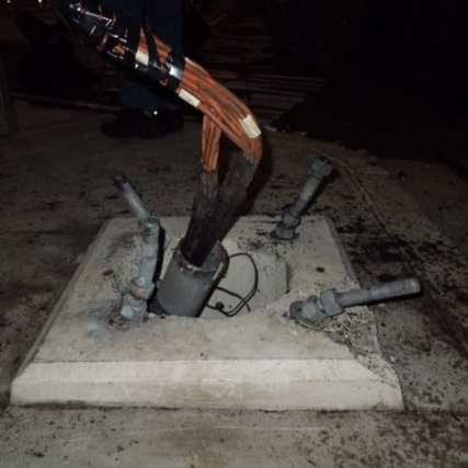 The damaged pole at Arlington/Exposition that normally supports a railroad crossing arm. photo by Metro.