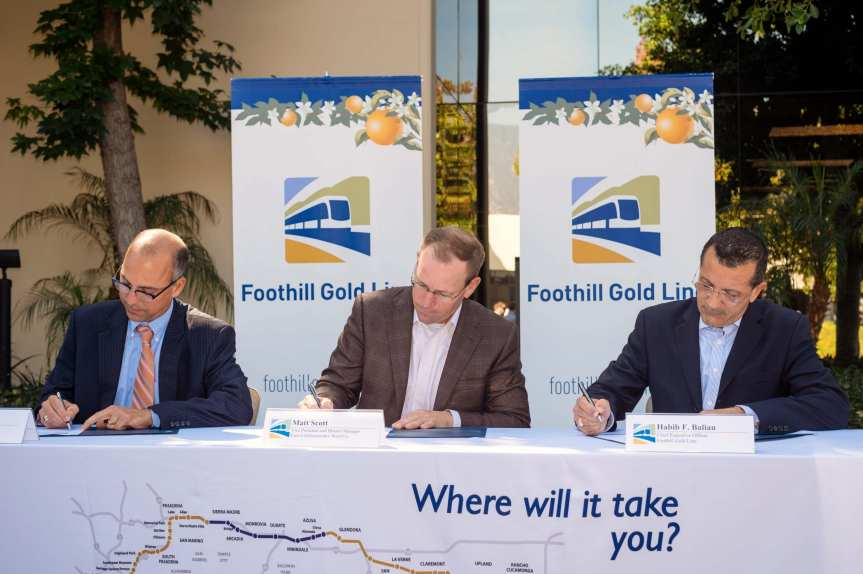Officials with the Foothill Extension Construction Authority and the contractor sign the certificate of substantial completion on Wednesday morning in Monrovia. Photo: Steve Hymon/Metro.