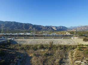 A Gold Line test train crossing the new bridge over the San Gabriel River between the Duarte and Irwindale stations.
