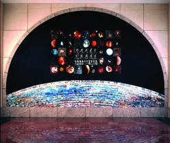 Epoch by Patrick Nagatani. A photo collage mural in the Metro HQ Boardroom lobby presents the idea of transportation from an individual to a global perspective.
