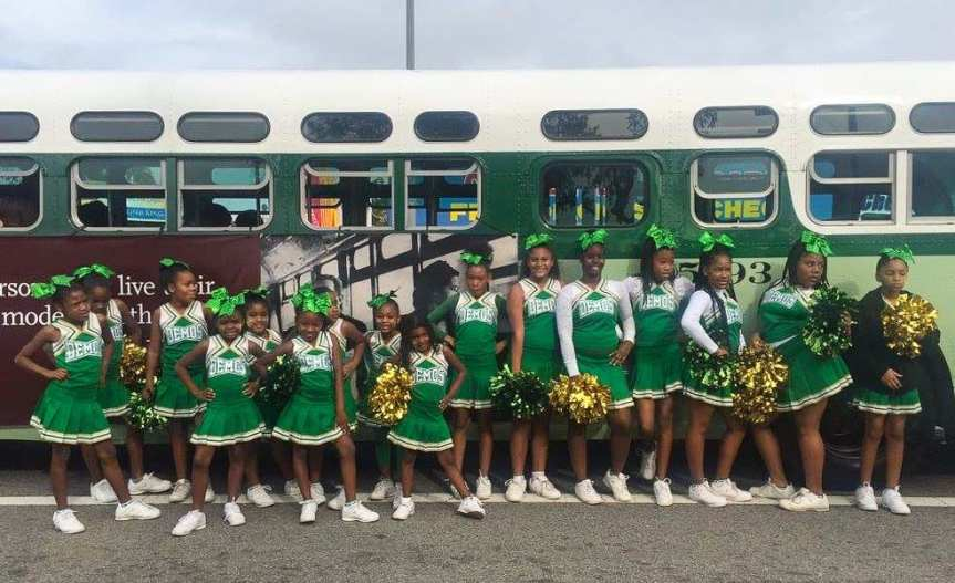 Cheerleaders and Metro's old-timey bus that made an appearance in Monday's Kingdom Day Parade celebrating the legacy of Martin Luther King, Jr. Photo: Metro.