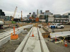 Preparations for installation of pedestrian walkways along shoofly track.
