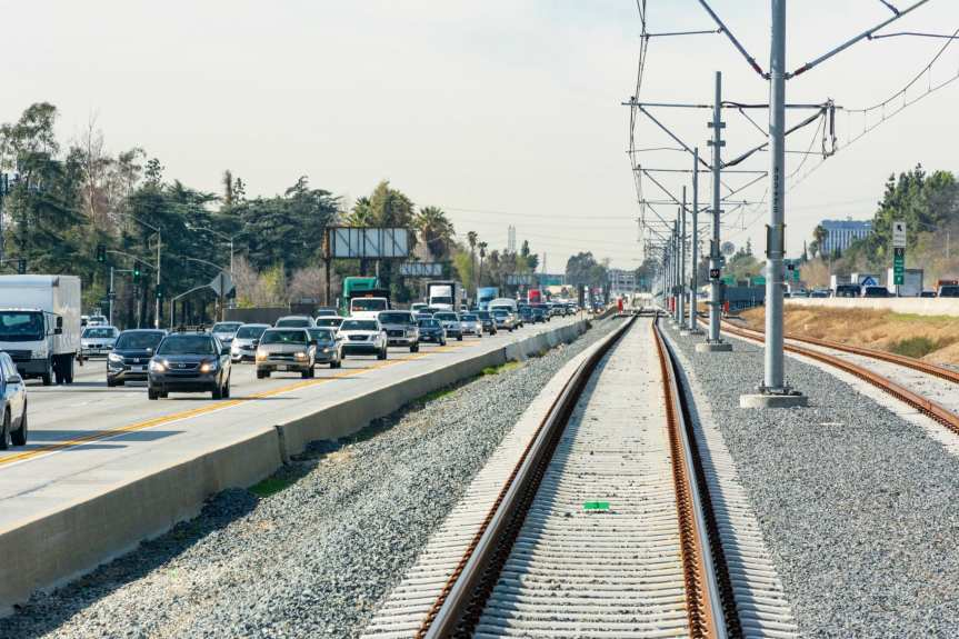 Looking from the rear of the train on the new Gold Line Extension at mid-day on a Thursday in February when traffic on the 210 was heavy but not its usual rush hour snarled self. Photo by Steve Hymon/Metro.