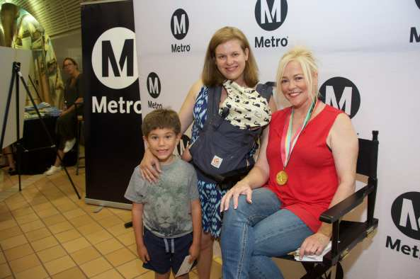 Julianne McNamara greets riders on Thursday at North Hollywood Station. Photos by Gary Leonard for Metro.