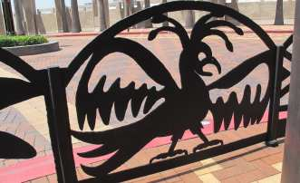 """""""Guardians of the Track"""" by artist Michael Amescua. 79 new artwork panels have been added to Union Station's Patsaouras Bus Plaza.""""Guardians of the Track"""" by artist Michael Amescua. 79 new artwork panels have been added to Union Station's Patsaouras Bus Plaza."""