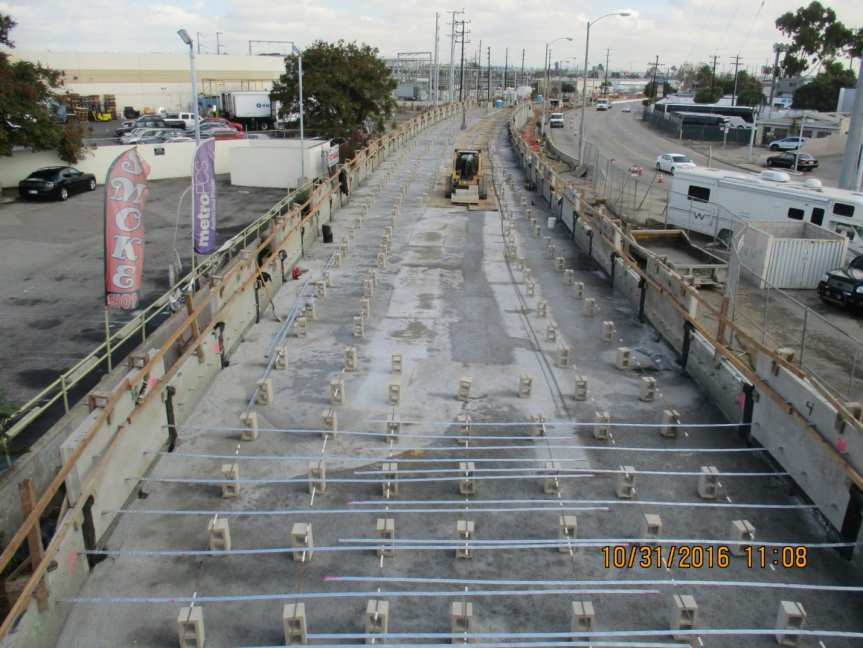 mse-122-l-r-north-of-manchester-blvd-construction-of-wall-erecting-precast-panels-and-setting-anchoring-galvanized-reinforement-straps