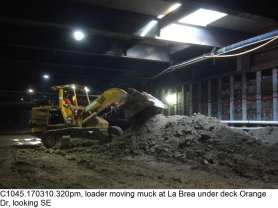 C1045.170310.320pm, loader moving muck at La Brea under deck Orange Dr, looking SE