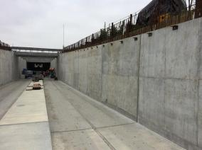 Barrier wall construction underway above the open u-walls on section of track next to LAX runways.