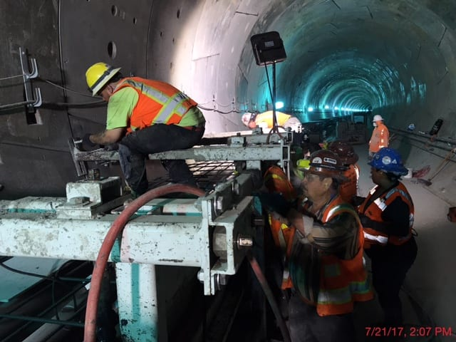 Installing a walkway on the southbound tunnel under Crenshaw Boulevard on the northern end of the project.