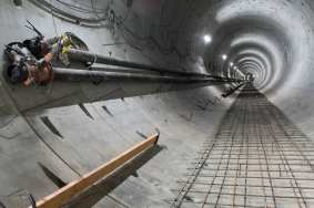 Now that the tunnels are built, crews start installing track and system components. Photo by Ken Karagozian.