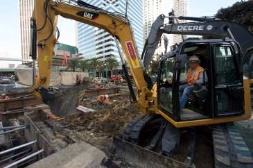 Excavating Flower St to make room for deck beams and panels. Photo by Gary Leonard, 2017.