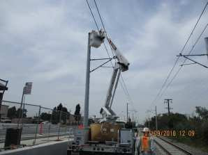 Installation of lights on Overhead Catenary System west of Centinela Ave.