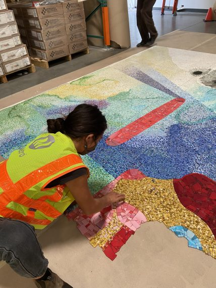 Metro Art staff carefully laying out one of over 750 sheets of glass mosaic during dry-fit.