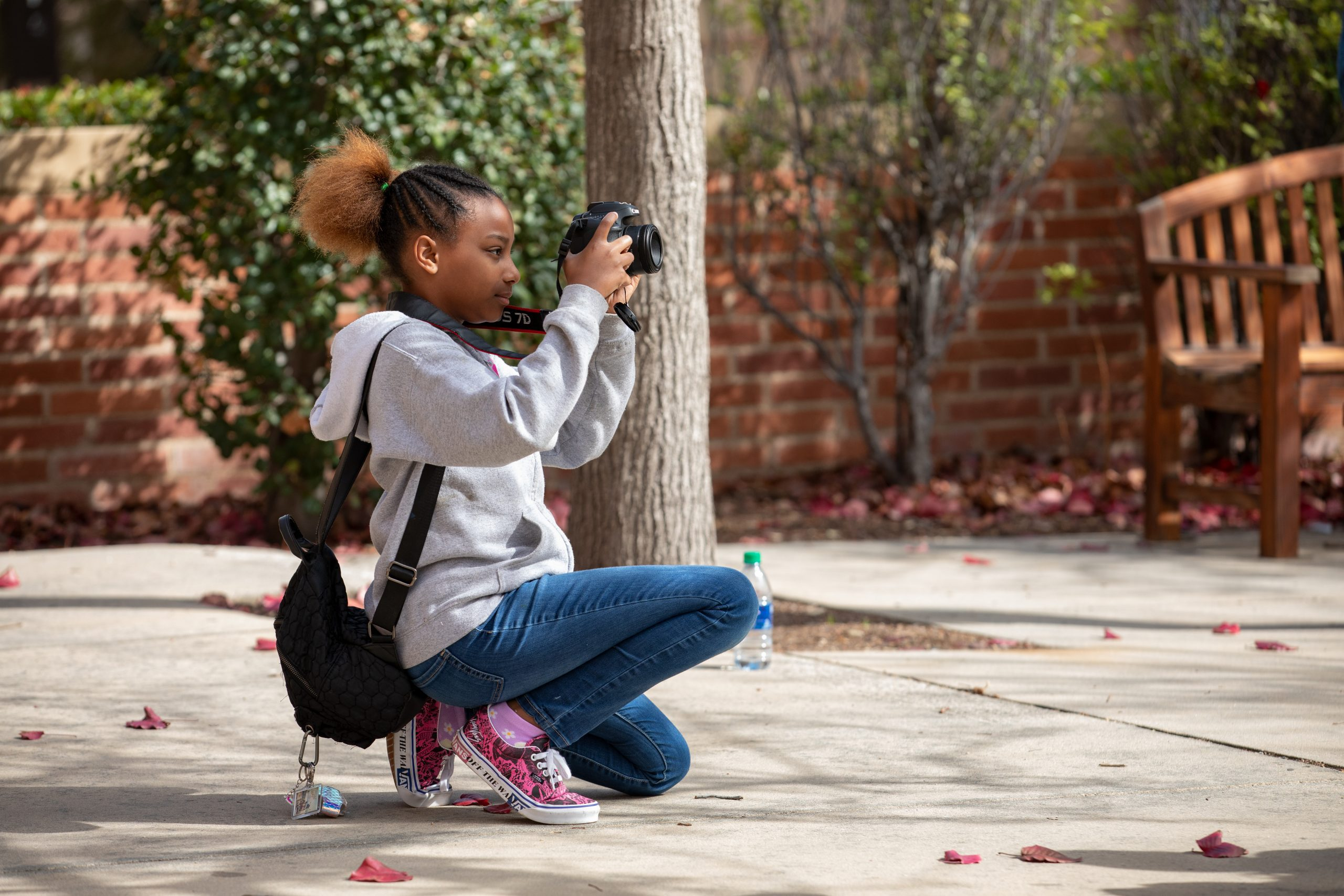 West Angeles Church Girl Scout practicing how to use an SLR camera