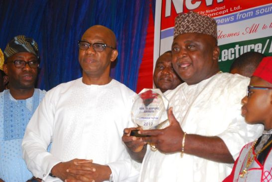 Hon Oladipupo Adebutu (r) receiving a plaque from Prince Dapo Abiodun
