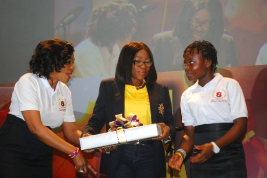 Mrs Bolanle Ambode, presenting a gift to one of the beneficiary,flanked by Senator Oluremi Tinubu