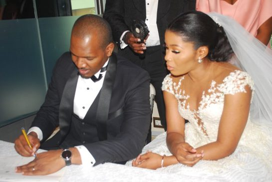 The Couple signing the marriage register
