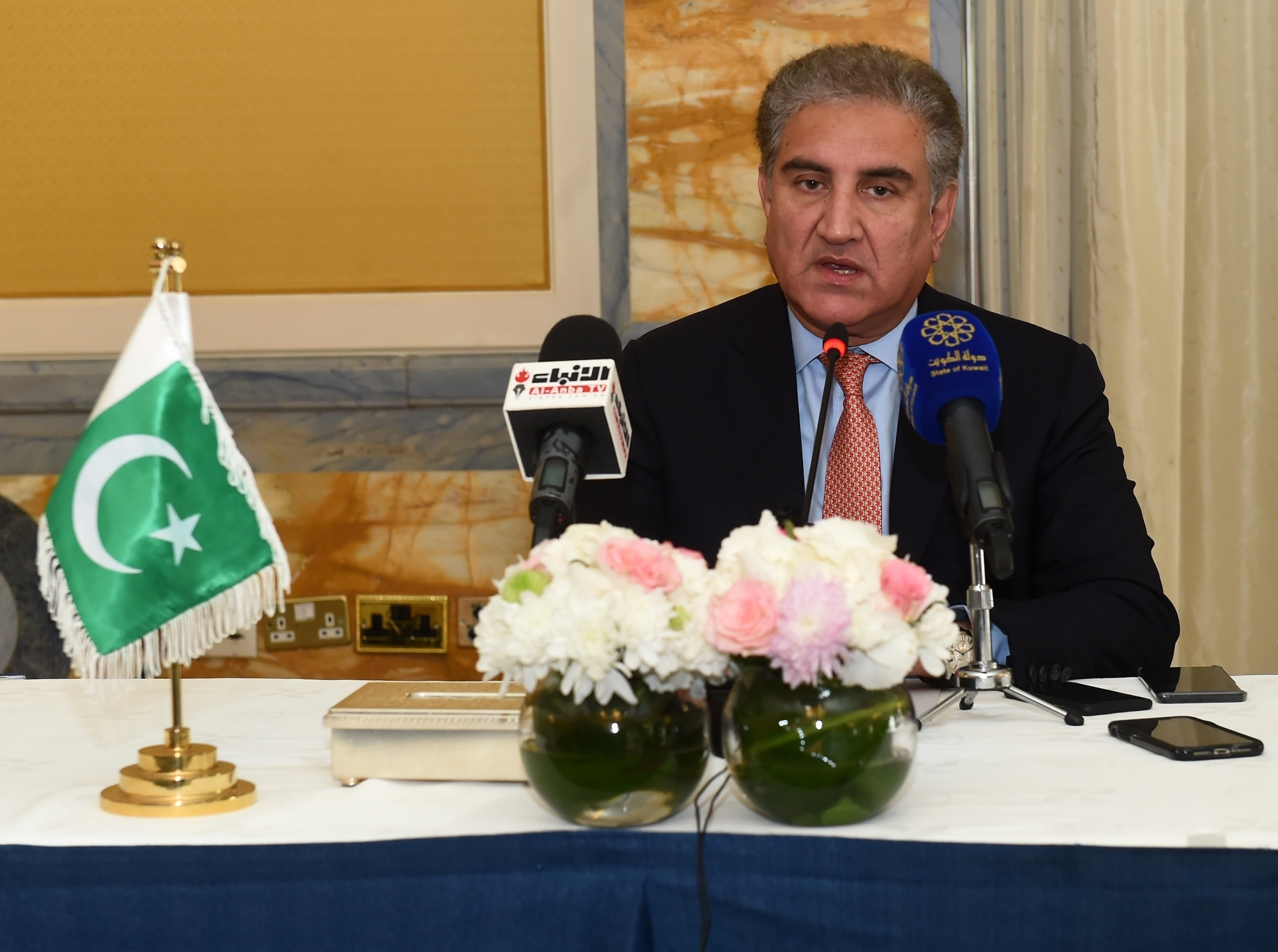 KUWAIT CITY, May 19, 2019 (Xinhua) -- Pakistani Foreign Minister Shah Mahmood Qureshi speaks at a press conference in Kuwait City, Kuwait, on May 19, 2019. Pakistan is ready to facilitate de-escalation of tension in the region and support peace and stability, visiting Pakistani Foreign Minister Shah Mahmood Qureshi said here on Sunday. (Xinhua/Asad/IANS)