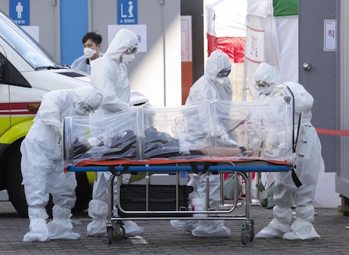 SEOUL, March 11, 2020 (Xinhua) -- Medical workers transfer a patient to a hospital in Seoul, South Korea, March 11, 2020. South Korea confirmed 242 more cases of the COVID-19 on Tuesday, raising the total number of infections to 7,755. Six more deaths were reported, lifting the death toll to 61. The total fatality rate stood at 0.77 percent. (Photo by Lee Sang-ho/Xinhua/IANS)