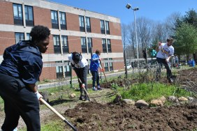 Students tended the garden during the event on Saturday.