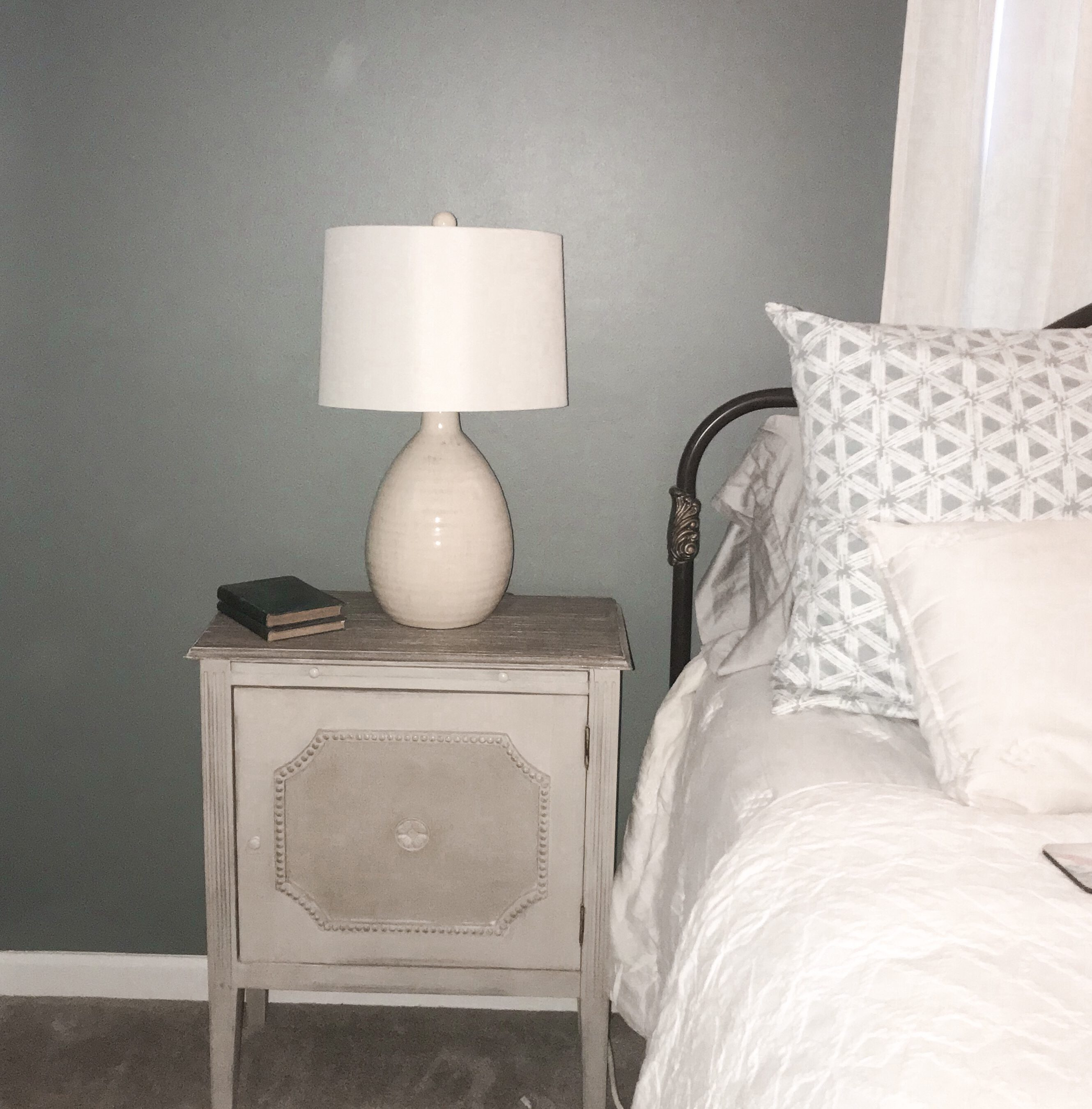 before bedside table with ugly lamp