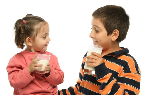 An image depicting two children drinking soymilk, the only approved non-dairy alternative..