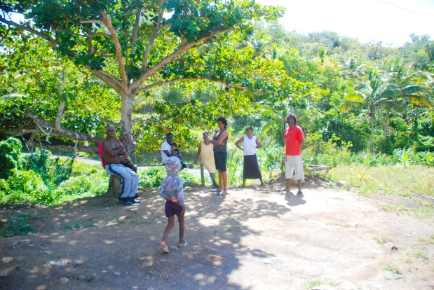 Family gather at the home of Marcellina Albert, the grandmother of TJ Elibox, in Augier, Vieux Fort.