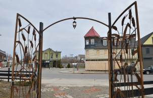 The iron gates installed on the Five Points property. Their original location is across the street in the green building.