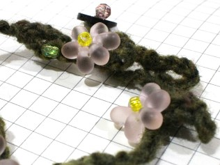 Sakura close up. Brioche beads for petals. A regular bead for the centre.