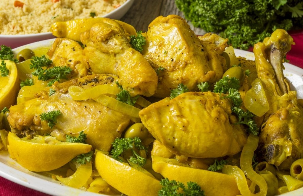 platter full of Moroccan chicken with lemons and olives served with couscous
