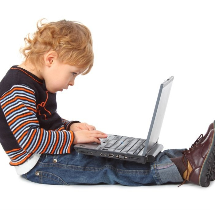 Boy with laptop at profile