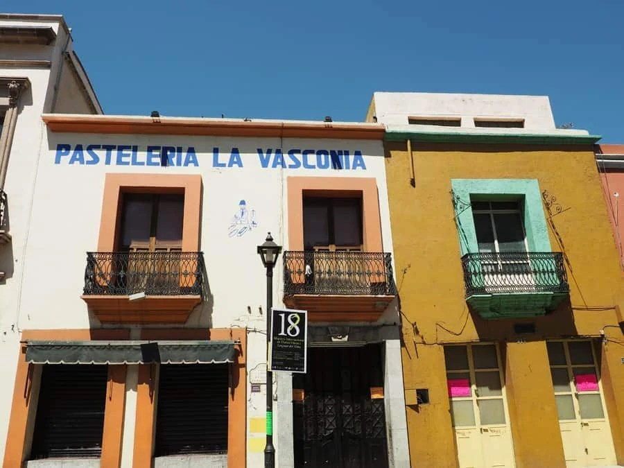 Colorful and bright buildings in Oaxaca City, Mexico! | via The Spirited Violet