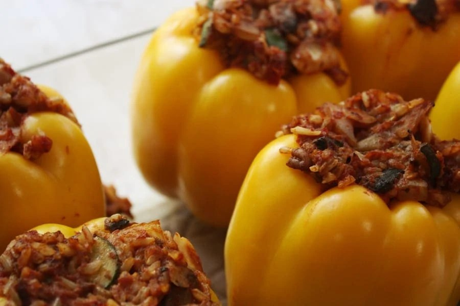 Gluten free and vegan stuffed bell peppers: yummy stuffed bell peppers that are delicious, nutrient dense, and easy to make! Definitely one to make again for the family! | via The Spirited Violet
