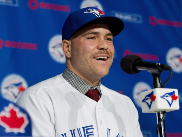 Toronto Blues Jays newly-signed catcher Russell Martin speaks to the media during a press conference in Toronto on Thursday, November 20, 2014. THE CANADIAN PRESS/Nathan Denette