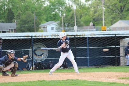 Chambersburg's Joey Maun (24) takes a swing at a pitch during the Trojans' 4-2 loss to Cedar Cliff on Thursday. Maun had the team's only RBI. (photo by Darby Sells).