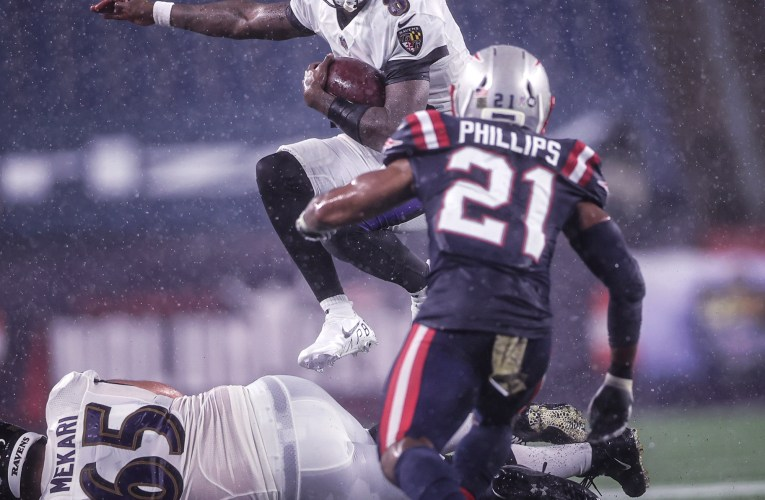 Ravens fall in the rain as Pats win