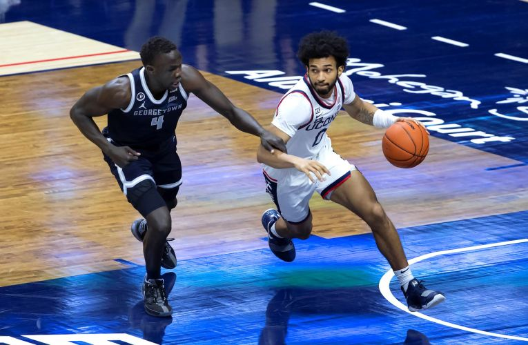 Huskies cruise past Hoyas, 98-82