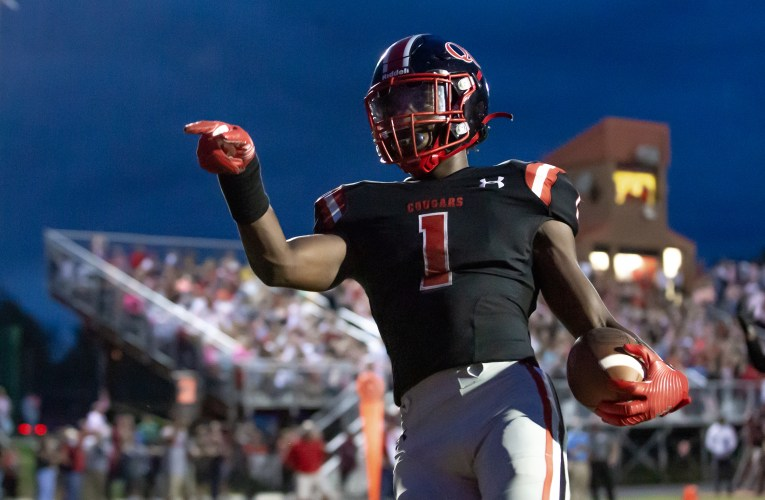 PHOTOS: Quince Orchard football routs Richard Montgomery