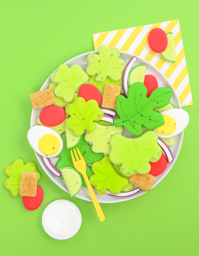 salad sugar cookies laying on a white plate with yellow fork