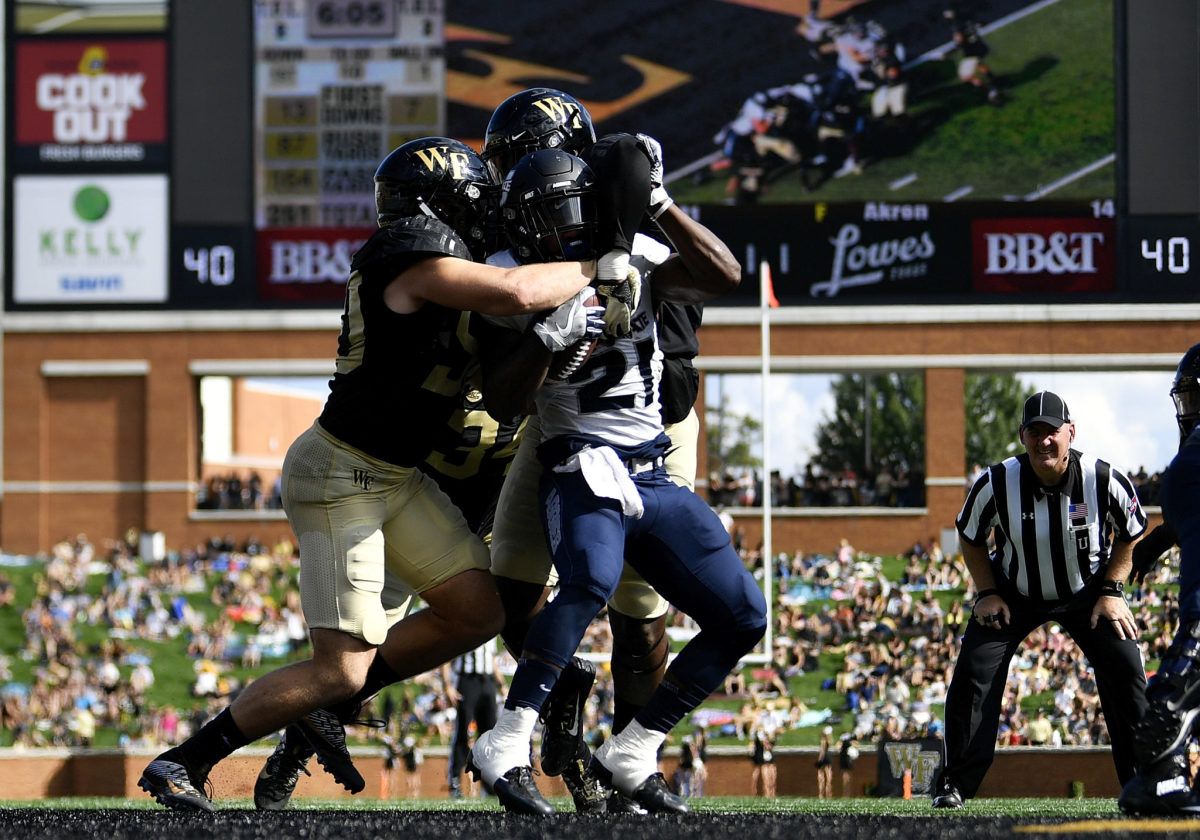 Wake Forest defensive end Carlos Basham in on a tackle against Utah State.