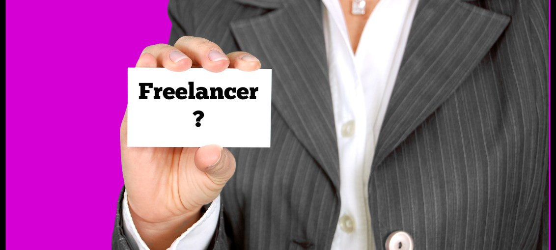 picture of a sign with a person holding up a business card with the word freelancer