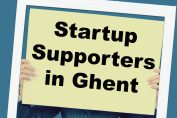 This is a picture of a person holding a board saying Startup Supporters in Ghent