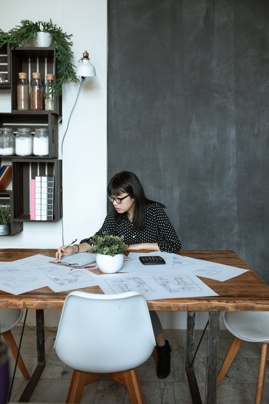 photo of woman working on desk