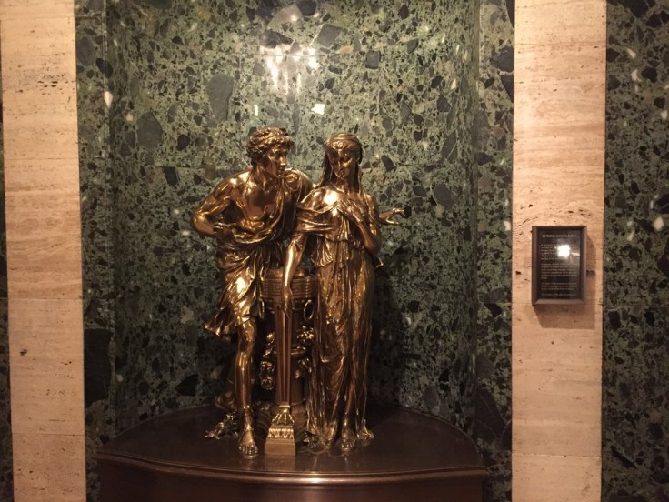 """At the top of the stairway in the Palmer House foyer are """"Romeo & Juliet"""", a statue that has greeted Palmer House guests since 1924"""