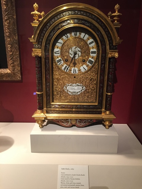 Table Clock, 1675. Walnut, ebony, gilt brass, enamel, red stained tortoise shell, pewter, brass, glass, steel, metals. Made by Nicolas Gribelin, France.