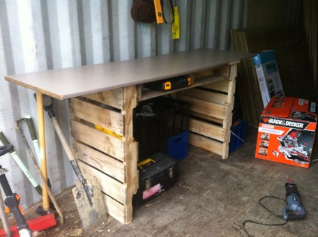 My first workbench. Constructed from pallets and an old kitchen cupboard